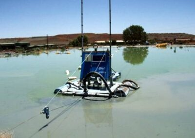Jetting Dredge functioning on overflowing sediment pond